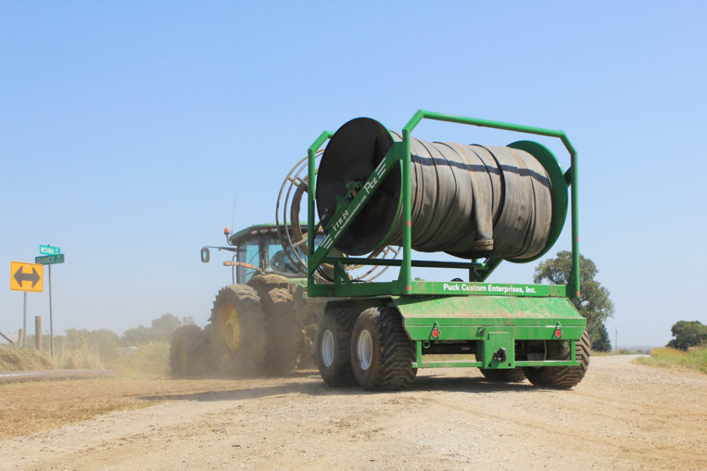 Tractor properly transporting a Puck hose reel